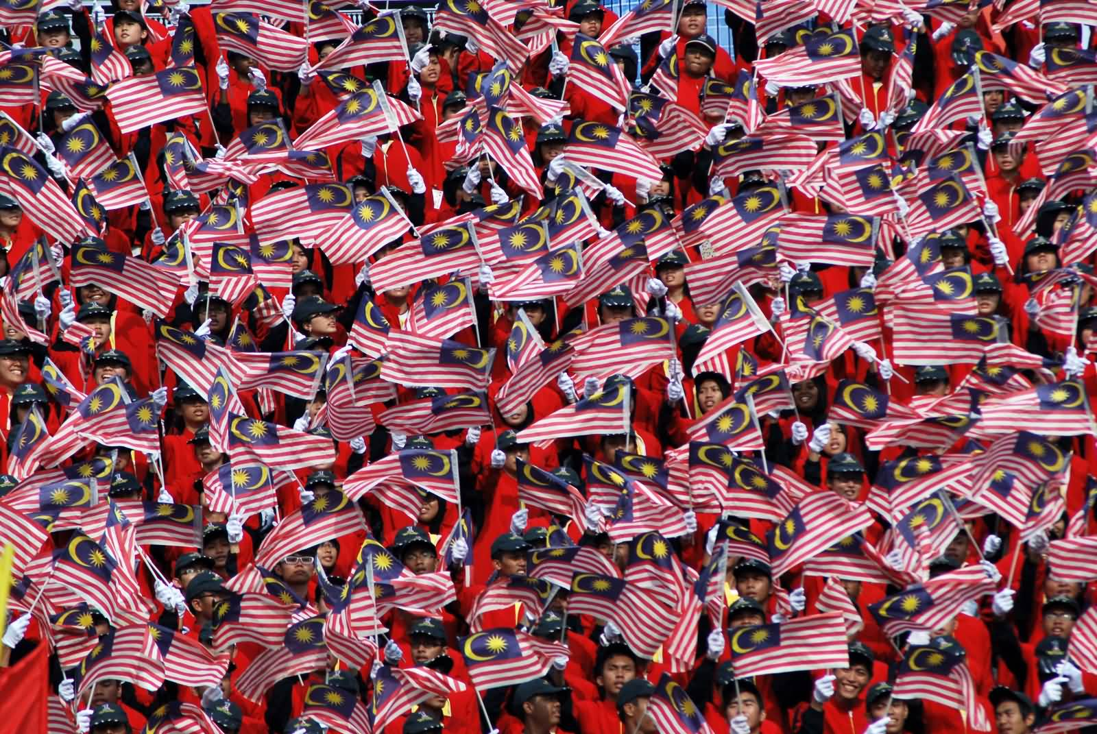Malaysians-Waves-Their-National-Flags-During-Malaysia-Day-Celebration